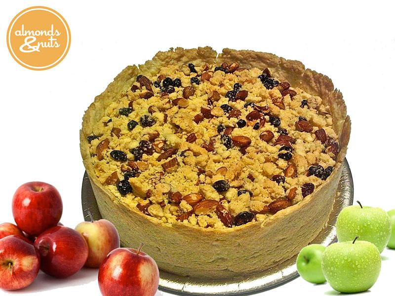 Torta de manzana con crumble de almendras, nueces y pasas